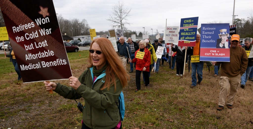 Charlene Edwards leads about 100 retirees from Y-12 gathered along Scarboro Road to the old guard tower near the entrance to the plant to protest changes in their benefits Thursday, Dec. 4, 2014.   (MICHAEL PATRICK/NEWS SENTINEL)