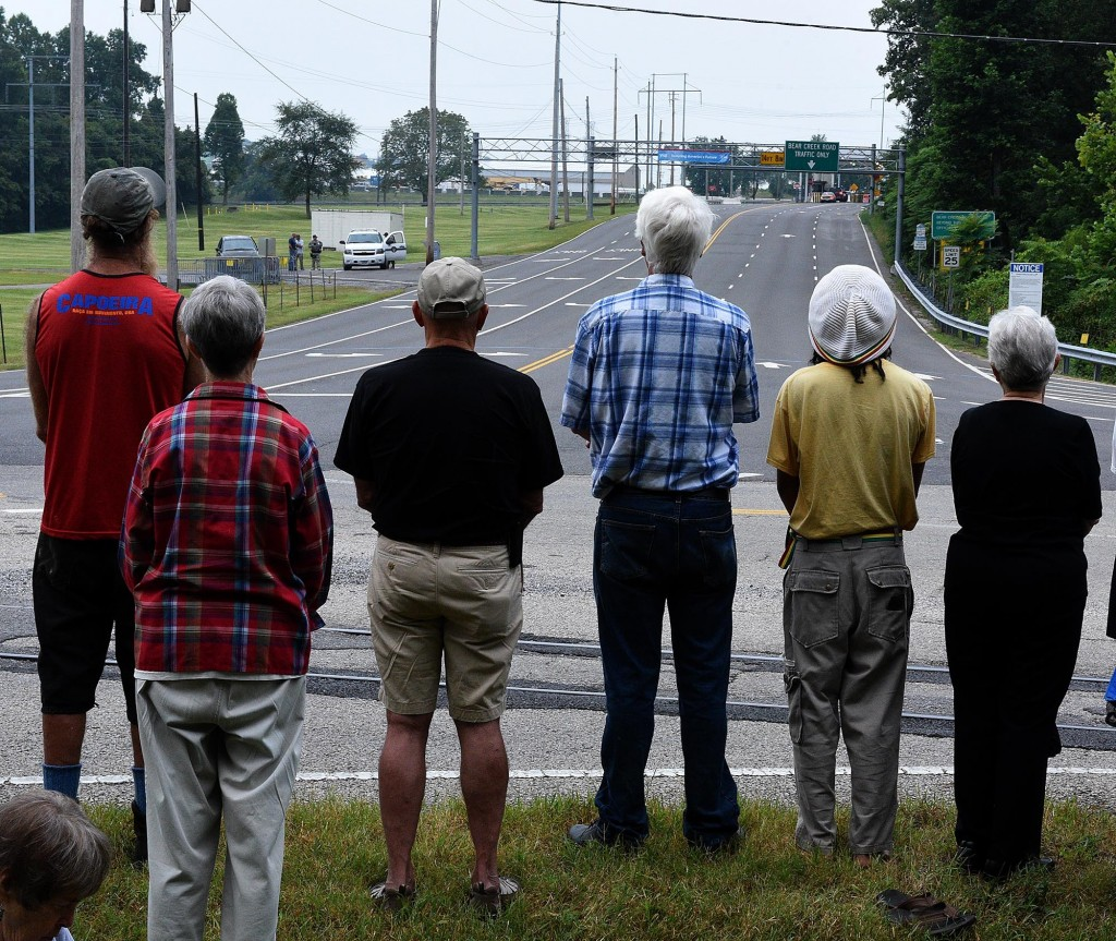 A small security team were visible during the Oak Ridge Environmental Peace Alliance Names and Remembrance Ceremony outside the Y12 Nuclear Weapons Complex East Bear Creek entrance Thursday, Aug. 6, 2015. The ceremony includes reading of names of victims of the August 6, 1945, atomic bombing of Hiroshima, Japan, using uranium produced ay Y-12. It's the 70th anniversary of the event in Japan. (MICHAEL PATRICK/NEWS SENTINEL)