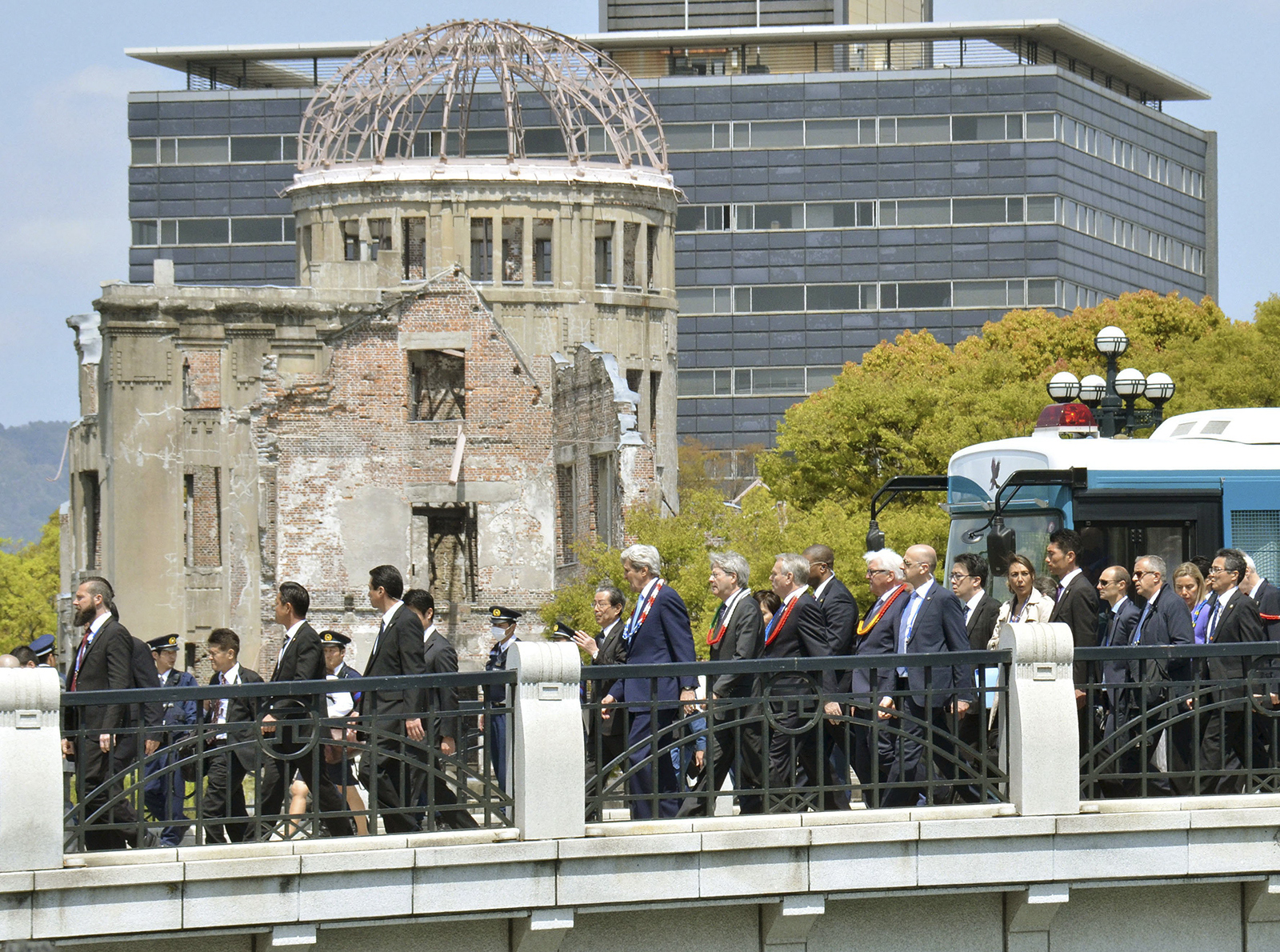U.S. Secretary of State John Kerry, center, walks past A-Bomb Dome after visiting the site in Hiroshima, western Japan Monday, April 11, 2016. Kerry visited the revered memorial to Hiroshima's atomic bombing on Monday, delivering a message of peace and hope for a nuclear-free world seven decades after United States used the weapon for the first time in history and killed 140,000 Japanese. (Shingo Nishizume/Kyodo News via AP)