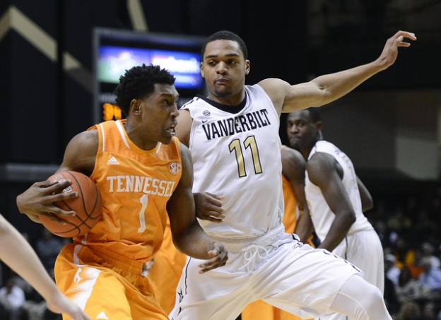 Tennessee guard Josh Richardson (1) drives past Vanderbilt forward Jeff Roberson (11) during the second half of an NCAA college basketball game Wednesday, Feb. 11, 2015, in Nashville, Tenn. Tennessee won in overtime, 76-73. (AP Photo/Mark Zaleski)